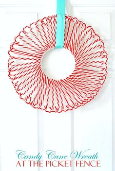 ^Candy Cane Wreath    Supplies:  one white Styrofoam wreath form  9-10 packs of Dollar Tree acrylic candy canes (depending on size of wreath form)  white or iridescent glitter (optional)  white craft glue  hot glue gun and low temp glue sticks (appropriate for using on Styrofoam)  Ribbon for hanging