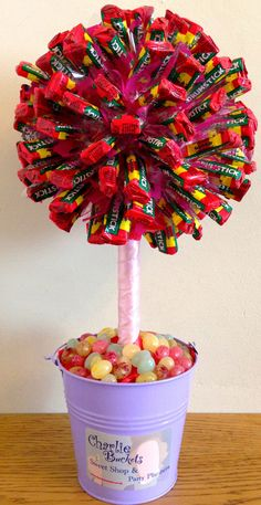 Drumstick lolly sweet tree  fantastic price  www.charliebuckets.co.uk Chocolate Tree, Chocolate Bouquet, Chocolate Baskets, Candy Topiary, Candy Trees, Diy Bouquet, Candy Bouquet, Bouquets, Homemade Gifts