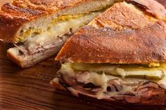 Cuban Sandwiches --------- used mayo & mustard, roast pork loin from deli. No panini press - oven 500 with cast iron skillet and press for 1 hour. Remove and place on trivet. Place sandwiches in skillet, top with press, 15 min. Wrapping in foil= soggy.