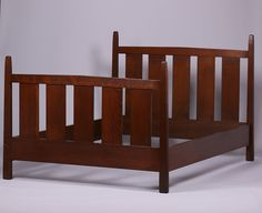 Gustav Stickley double bed with tall tapered posts designed by Harvey Ellis.  Signed with paper label. Very sturdy.  | 46.5″h x 56″w x 78.5″d | Arts and Crafts Movement | Craftsman Bungalow | Mission Style