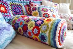 Inspiration  Rainbow Flower Crochet Bolster by julia crossland, via Flickr  Homemade, crochet hook,, granny square, DIY #crochet, wrap, blanket, lap, cover, covering,  afghan, carpet, cloak, coat, coating, comforter, covering, coverlet, envelope, film, fleece, layer, mat, puff, quilt, rug, sheath, sheet, throw, wrapper