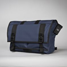"""The Rummy Messenger Bag features a weatherproof roll top main compartment which can be used in either the """"roll top"""" mode, or in the traditional """"flap down"""" configuration. The Rummy is a cu."""