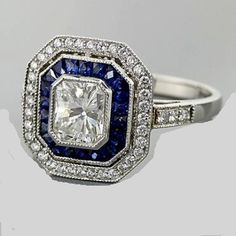 Art Deco Platinum Milgrain ring featuring Carat Radiant Cut Diamond center bezel set consisting of 20 Specialty Cut Sapphire Gem Stones equaling Ct. Bijoux Art Deco, Art Deco Jewelry, Fine Jewelry, Jewellery, Deco Engagement Ring, Antique Engagement Rings, Diamond Engagement Rings, Antique Jewelry, Vintage Jewelry