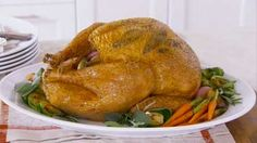 How to Cook a Turkey with Herbs  Give your turkey big flavor using herbs. We'll show you how to do it