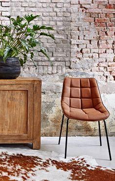 De gestikte vormen geven deze stoel een stijlvolle en trendy look