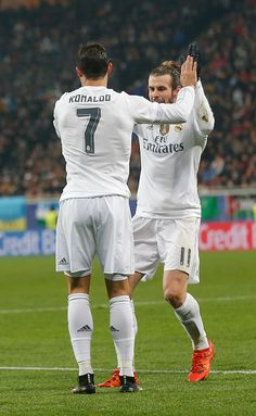 Cristiano Ronaldo celebrates after scoring with his teammate Gareth Bale during the UEFA Champions League match between FC Shakhtar Donetsk and Real...
