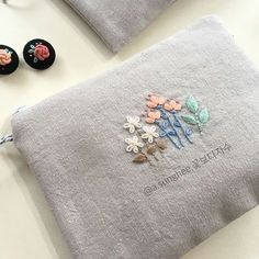 I just adore these little pouches with tiny embroidery