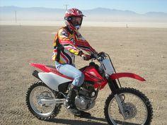 This is me on my Honda CRF-230F dirt bike. I love my bike like I would love a child!
