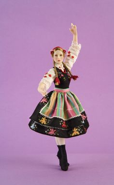NAME: Polish Dancer  BALLET: Swan Lake  PRICE: 900 euros  Traditional costume from the region of Lowicz (Poland), trimmed with silk ribbon embroideries. Pedestal included.