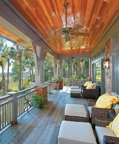 Nice big porch with nice seating and lovely lush landscaping.