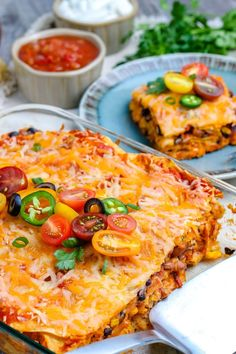 This stacked Chicken Enchilada Casserole recipe is easy to make, and it will be on your table in 50 minutes! It's some serious comfort food that your entire family will love. Recipes With Enchilada Sauce, Red Enchilada Sauce, Chicken Enchilada Casserole, Chicken Enchiladas, Sauce Recipes, Mexican Food Recipes, Dinner Recipes, Mexican Meals, Dinner Ideas