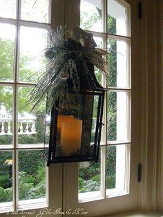 Window decor using lanterns, flameless candles and pine sprays form Melrose.      http://www.melroseintl.com/c-123-lanterns.aspx?1=1