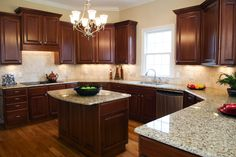 Dark kitchen cabinets – love the grayish countertop I like the lay out better than the darkness ! Dark kitchen cabinets – love the grayish countertop I like the lay… Dark Wood Kitchens, Dark Kitchen Cabinets, Brown Cabinets, Kitchen Units, Kitchen Redo, New Kitchen, Home Kitchens, Kitchen Ideas, Cherry Kitchen