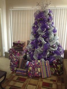 Christmas tree decorating with purple deco mesh by DeeDeeBean