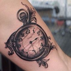 Love the filigranes and the style of the tattoo. I would like to get inked a compass rather than a clock, but the overall concept of this tattoo design is very appealing. #tattoo #blackandgrey