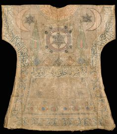 16th-century Ottoman talismanic shirt is covered in intricate scripts, including Muhaqqaq, Naskh, Ghubar, Thuluth and square Kufic. This shirt, with its decoration, parallels a group of similar Ottoman shirts in the Topkapi Saray Museum, all dating from the 15th and 16th centuries, with the crescent moon and cypress trees so common in 16th-century Ottoman styles (shown above from the front, below from the back).