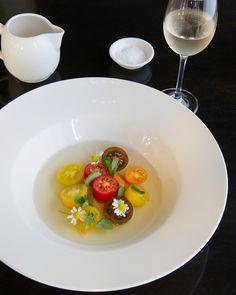 Heirloom tomatoes, bulb onions,chamomile  flowers, purslane, tomato consomme