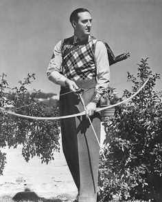 Basil Rathbone with a Howard Hill longbow.