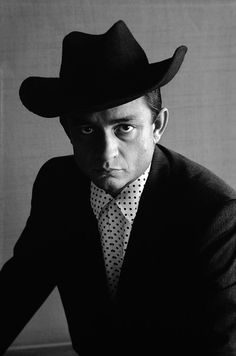 Johnny Cash wears the black hat - photo by Don Hunstein.