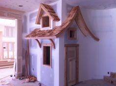 kids room: playhouse under the stairs