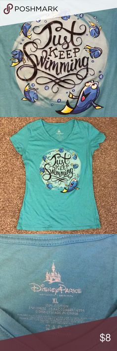 Just Keep Swimming XL T-shirt Just Keep Swimming! This is a fun Finding Nemo t-shirt featuring our beloved.....what was her name again? Oh yeah! Dory! The shirt does have the original price written on the inside bottom of the shirt. It is not noticeable when wearing. Disney Tops Tees - Short Sleeve