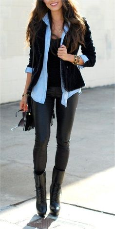 Black vest, denim shirt, black pants, patterned top or scarf