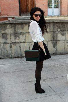 Black tights, skater skirt, white collared shirt.