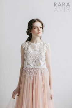 Wedding dress Mensi by Rara Avis. Sleeveless V-neck pale peach feather embellished bodice dreamy romantic wedding dress. Ship worldwide. Based in Vancouver, Canada.