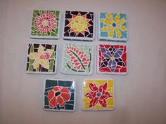 Want to learn how to make mosaic coasters like these? Auctionopia offers a Glass Mosaic Coaster Kit to do just that!