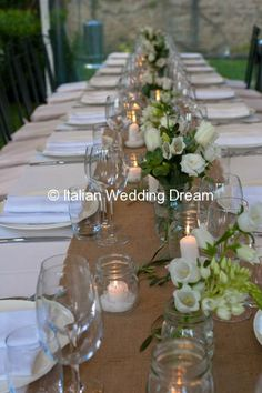 Wedding table with flowers & succulents + candles in mason jars | Italian Wedding Dream