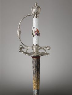 Small Sword • Maker: Jan Nieuwland (Dutch, Amsterdam, active 1747–1807) • Dated: circa 1750 • Geography: Amsterdam • Culture: Dutch, Amsterdam • Medium: silver, Meissen porcelain grip, steel, gold •...