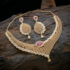 Full white stone neck lace witch its emphisis red stone at the center. www.shopzters.com