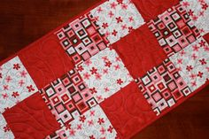 This fun quilted table runner was made by two friends who love to quilt together. We created the table runner with fabrics from Sandy Gervais's