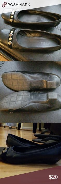 Vaneli black pair of flat shoes size 7.5 women's Vaneli black pair of shoes with less than a 1/2 inch heal. Gently worn. They run a little bigger than  a 7.5 shoe. My heal slips out of them while walking. Silver and gold hardware accent toe of shoe. Van Eli Shoes Flats & Loafers