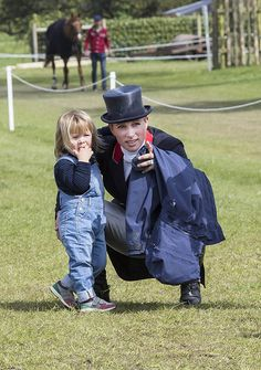 Hello! Mia Tindall with her mother Zara Phillips, a competitor at Badminton Horse Trials, May 6, 2016