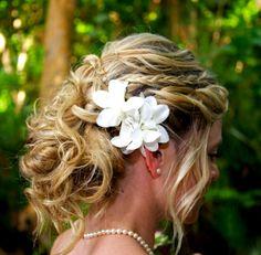 Bride's messy chignon bun bridal hair ideas Toni Kami Wedding Hairstyles ♥ ❶ side gardenia gorgeous wedding hairstyle
