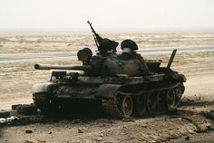 The charred remains of an Iraqi T-55 main battle tank sits on the Iraqi-Kuwait border, destroyed by Coalition armor heading into Kuwait during Operation Desert Storm.