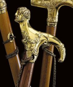 A CANE WITH GILT-METAL TAU-SHAPED HANDLE, THE HANDLE PROBABLY GERMANY, CA 1780
