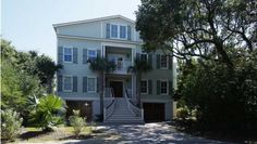 7 Abalone Aly, Isle Of Palms, SC 29451 - Custom-built home on a cul-de-sac in Wild Dunes with ocean views and a hop-skip to the beach. Reverse floor plan features a very spacious living area with large kitchen, dining room, living room, and rec space. There is a pool off the deck...
