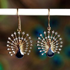 These gorgeous beauties make Monday worth it. #beautiful #earrings #peacock #lovegold #diamonds #instagold #instajewelry #statement #jewels