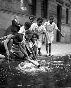 Fred Stein Children in Harlem, 1947  Love that she's the only one to connect with photographer, and with such a great smile..