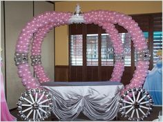 Balloon carriage with pink or silver table cloth for dessert table