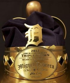 Detroit Tigers third baseman/DH Miguel Cabrera received an awesome crown trophy from MLB for winning the Triple Crown in the American League during the 2012 Detroit Sports, Detroit Tigers Baseball, Detroit Michigan, Pro Baseball, Old English D, Tiger Love, Baseball Pictures, Texas Rangers, Miguel Cabrera