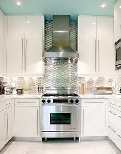 Blue ceiling - tall upper cabinets. Love the bright, cleanliness. Makes a small kitchen look bigger.