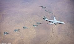 Ten No. 3 Squadron F/A-18A/B hornets fly in a formation over Australia's Northern Territor...