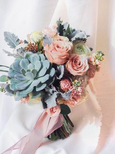 Pink wedding bouquet with succulents // Most Popular Bridal Bouquets {Facebook and Instagram: The Wedding Scoop}