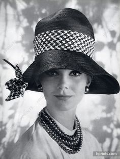 1c79e9d93e0 Model is wearing a black Italian straw cloche by Jean Barthet