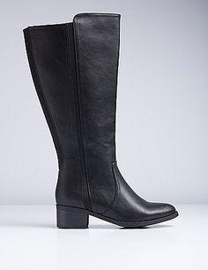 No bells and whistles on this pair. A classic riding boot speaks for itself, season after season. Short, stacked heel. Stretch goring on back and side for a comfier fit. Full-length side-zip closure. Wide widths. lanebryant.com