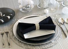 Pier1imports.com   Bright ideas, festive holidays.  Round Silver Tinsel Placemat • Silver Lacquer Charger • Black & White Salad Plate • Allure Salad Plate • Black Pintuck Napkin in Silver Bangle Napkin Ring • Black & White Bowl • Paris Hammered Flatware • Platinum Stripes Stemware • Silver Mosaic Pillar