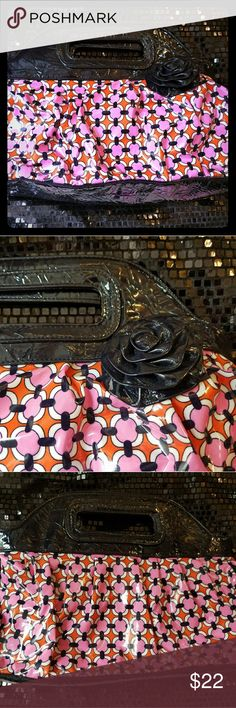 Pretty Vera Bradley Bag Bag looks brand new! Pretty floral pattern inside of it w pocket for phone. Outside is just as pretty! Plastic material on the outside. This is like a clutch purse, but large. Bundle w my other items for your best deal! #verabradley #purse #pocketbook #clutch #dogwalker1 #bundleandsave Vera Bradley Bags Clutches & Wristlets